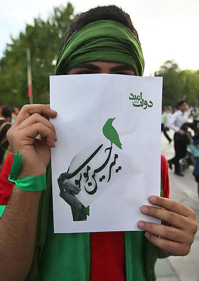 A supporter of Mir Hussein Mousavi on the eve of the Iranian elections of 2009, with a bird on his leaflet