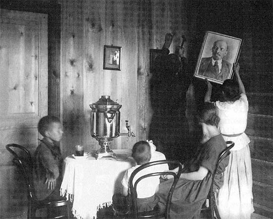 A Moscow family hanging up the portrait of Lenin in the new flat, 1927
