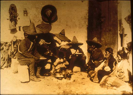 Mexico, Revolution. Soldiers in family circle. Photo by Agustín Victor Casasola (1874-1938). Cf. http://content-s10.cdlib.org/ark:/13030/hb6199p2k3/?layout=metadata&brand=calisphere