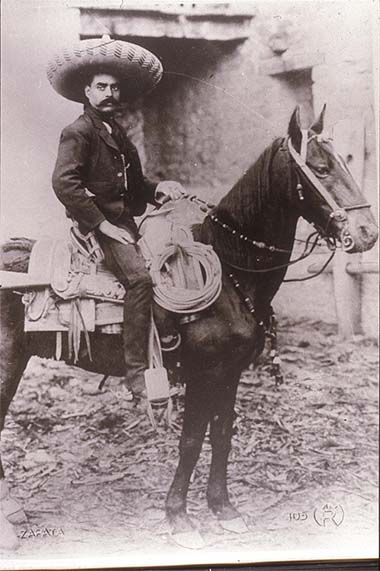 Mexico, Revolution. General Zapata on horseback. Photo by Agustín Victor Casasola (1874-1938). Cf. http://content.cdlib.org/ark:/13030/hb6p3009q4/?layout=metadata&brand=calisphere
